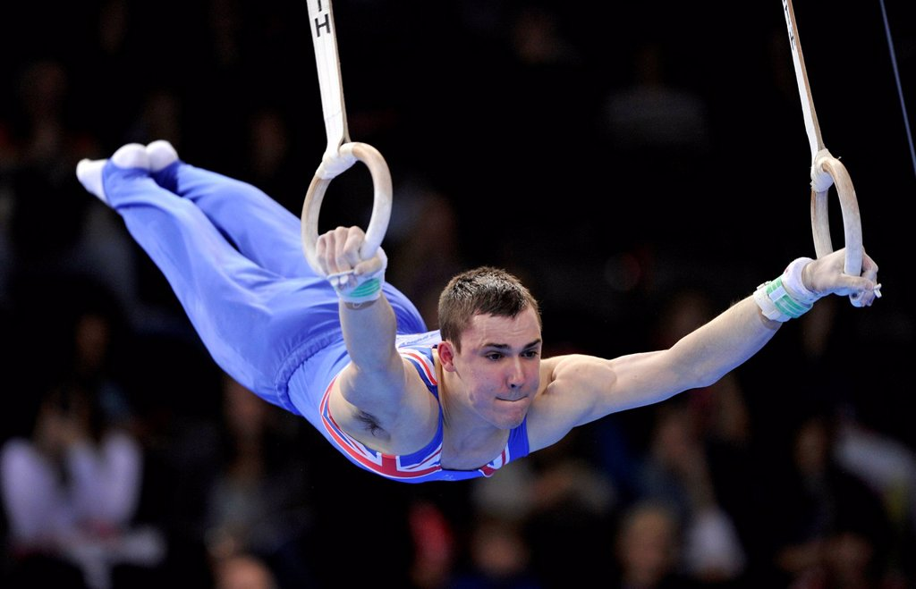 Samuel Hunter, GBR, performing on still rings, EnBW Gymnastics World Cup, 11 to 13 Nov 2011, 29th DTB Cup, Porsche_Arena, Stuttgart, Baden_Wuerttemberg, Germany, Europe : Stock Photo