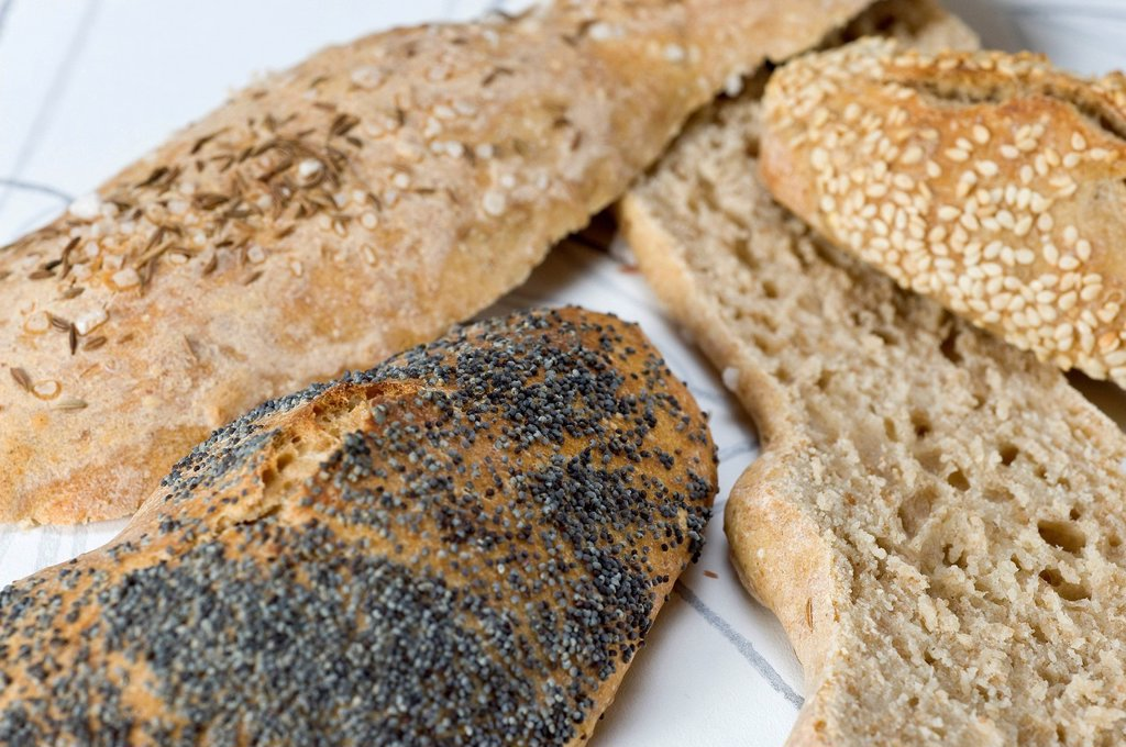 Home_baked bread rolls, sesame rolls, poppy seed rolls, Swabian bread stick, ´´Soul´´ : Stock Photo