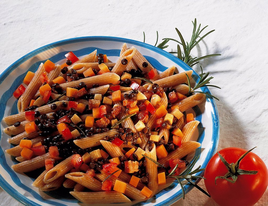 Wholemeal penne with lentil ragout, whole food cuisine, Italy, recipe available for a fee : Stock Photo