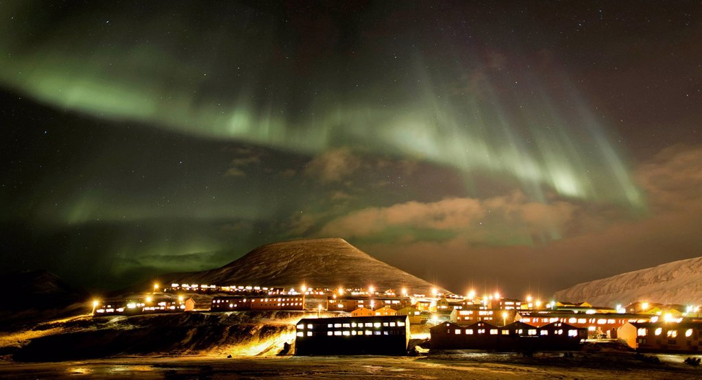 Panoramic view, northern lights, aurora borealis, above the town of Longyearbyen, Spitsbergen, Svalbard, Norway, Europe : Stock Photo