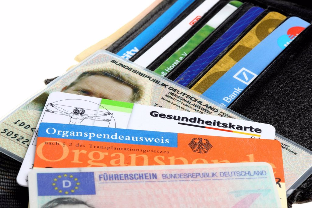 Stock Photo: 1848-715859 Wallet with various ID documents, identity card, driving license, health card, donor cards, credit cards and bank cards