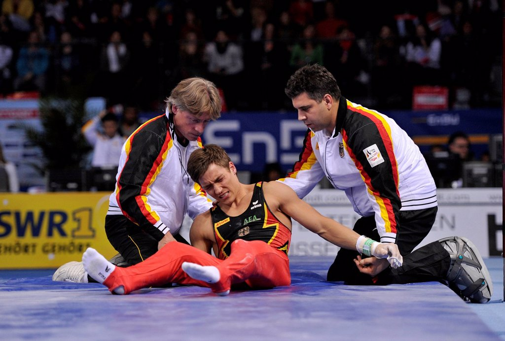 Stock Photo: 1848-716136 Philip Boy, GER, on ground after fall from high bar, with coaches, EnBW Gymnastics World Cup, 11 to 13 Nov 2011, 29th DTB Cup, Porsche_Arena, Stuttgart, Baden_Wuerttemberg, Germany, Europe