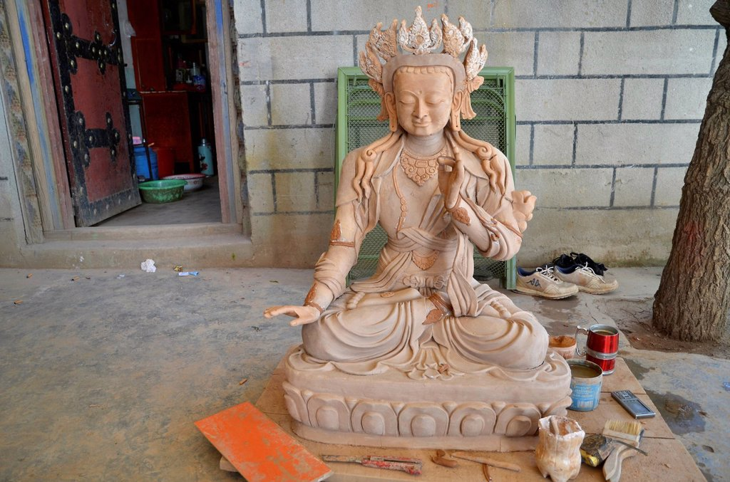 Stock Photo: 1848-716979 Tibetan handicrafts, Buddha statue in the making, unpainted, from wood and clay, Tibet, China, Asia