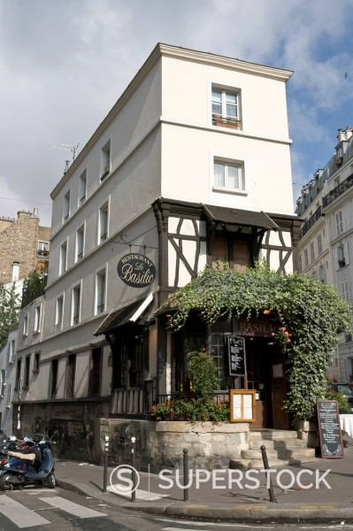 Building at the junction between Rue Lepic and Rue De Maistre showing traces of wood framework, hosting restaurant Le Basilic, Montmartre district, Paris, France, Europe : Stock Photo