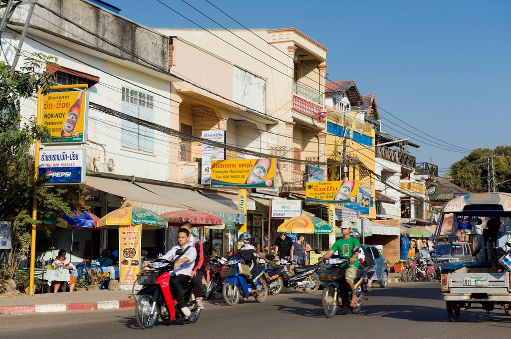 Traffic, shops and restaurants, Fa Ngum Road, Vientiane, Laos, Indochina, Asia : Stock Photo