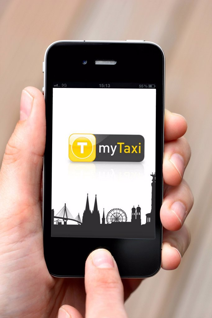 Iphone, smartphone, app on the screen, MyTaxi : Stock Photo