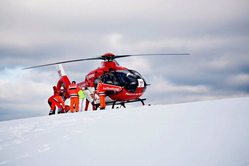 Rescue operation with a rescue helicopter in the Thuringian Slate Mountains, Thuringia, Germany, Europe : Stock Photo