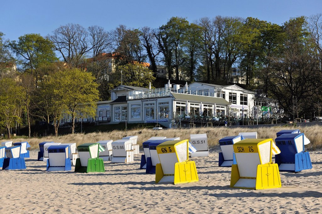 Roofed wicker beach chairs on a beach near Goehren, looking towards the Panorama beach cafe, Ruegen, Mecklenburg_Western Pomerania, Germany, Europe : Stock Photo