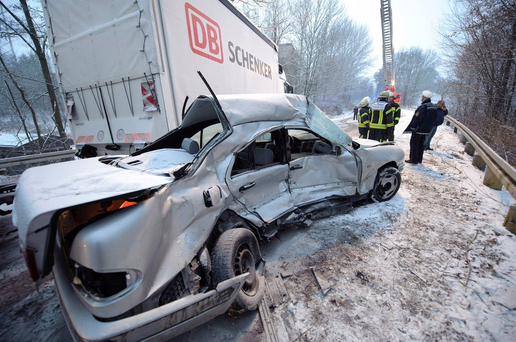 Fatal car accident on the slippery snow of an icy road, an E_Class Mercedes was hurled onto the opposite carriageway and collided with an oncoming truck, Stuttgart, Baden_Wuerttemberg, Germany, Europe : Stock Photo