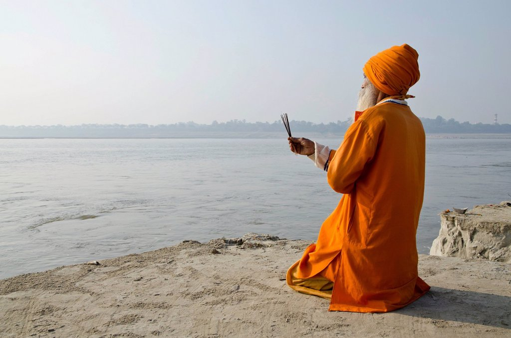 Stock Photo: 1848-719041 Sadhu, holy man, praying at Sangam, the confluence of the holy rivers Ganges, Yamuna and Saraswati, in Allahabad, Uttar Pradesh, India, Asia