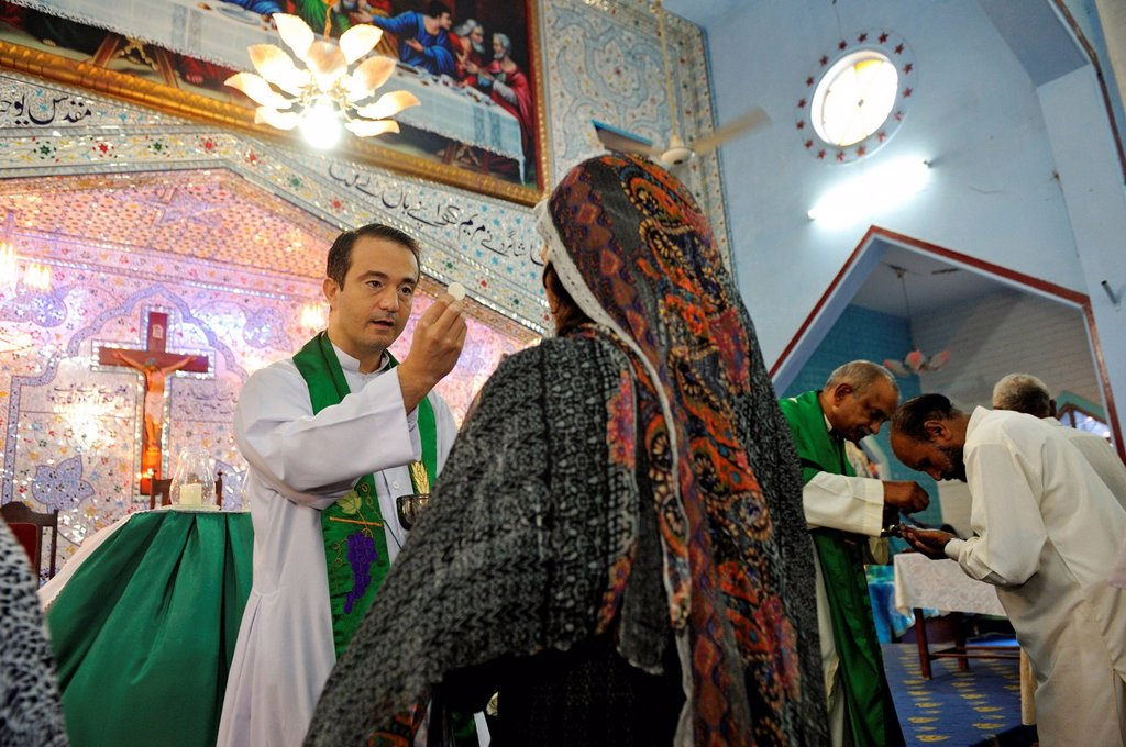 Stock Photo: 1848-719123 Mass, veiled woman receiving Communion, Parish Church of St. John, Christian community of Youhanabad, Lahore, Punjab, Pakistan, Asia