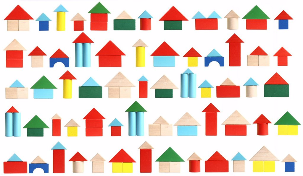 Many houses made of toy blocks, symbolic image living for in the city : Stock Photo