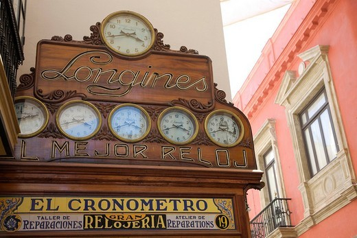 Stock Photo: 1848-71934 Clock shop El Cronomentro, facade featuring clocks showing various cities´ current times in Calle Sierpes street, Seville, Andalusia, Spain, Europe