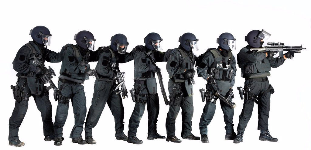 Police, Special Task Force, SEK, squad holding a metal battering ram and various weapons : Stock Photo
