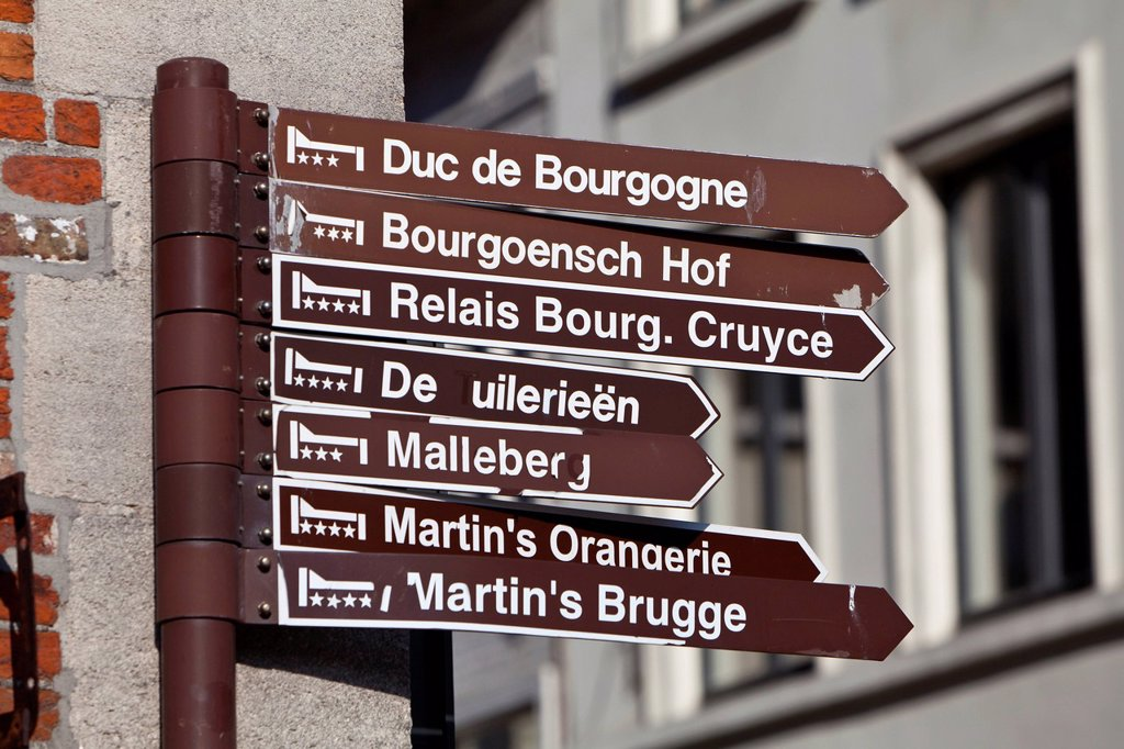 Sign indicating the route to various hotels, old town of Bruges, UNESCO World Heritage Site, West Flanders, Flemish Region, Belgium, Europe : Stock Photo