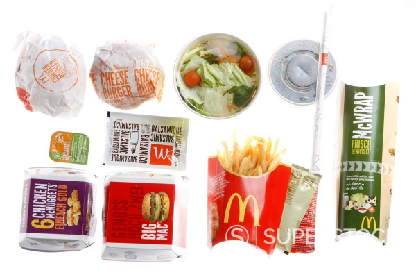 Fast food, various items from McDonalds, packed with a soft drink : Stock Photo