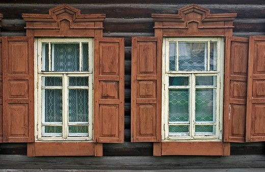 Windows with Ornamentic frames at different old Sibirian Wooden Houses, Omsk at the Rivers of Irtisch and Omka, Omsk, Sibiria, Russia, GUS, Europe, : Stock Photo