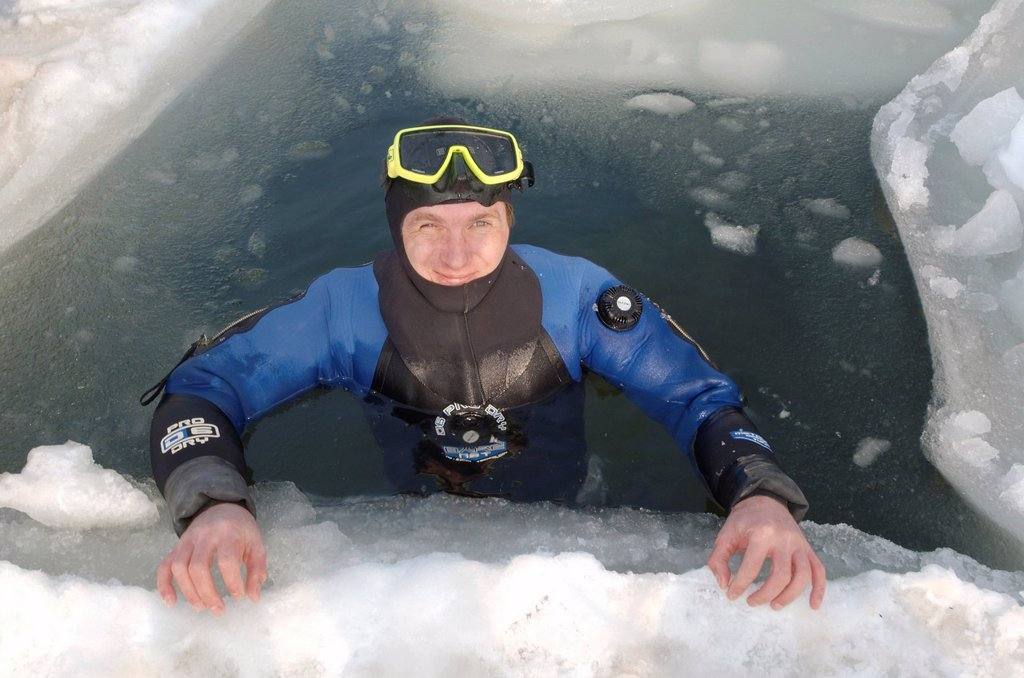Stock Photo: 1848-722795 Diver, preparing for subglacial diving, ice diving, in the frozen Black Sea, a rare phenomenon, last time it occured in 1977, Odessa, Ukraine, Eastern Europe