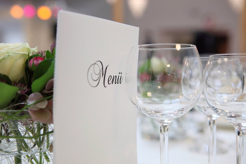 Banquet, dinner table, table decorated for a celebration with a menu card : Stock Photo