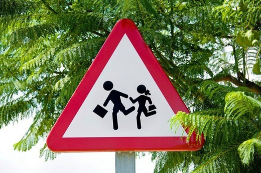 Traffic sign to be mindful of school children : Stock Photo