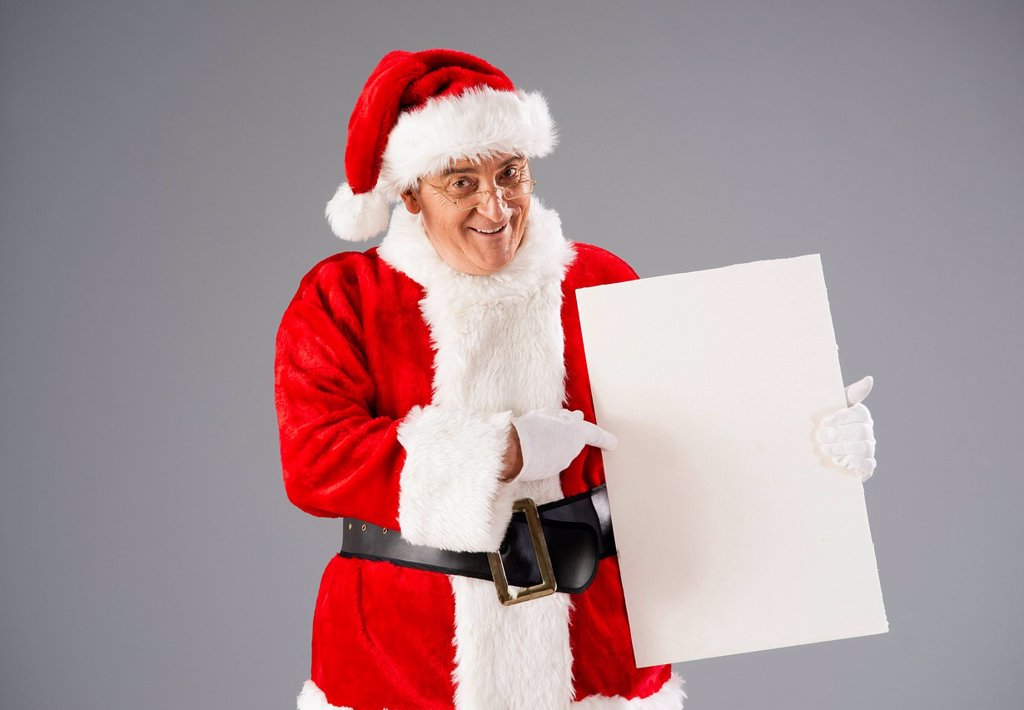 Stock Photo: 1848-727424 Santa Claus presenting a blank slate