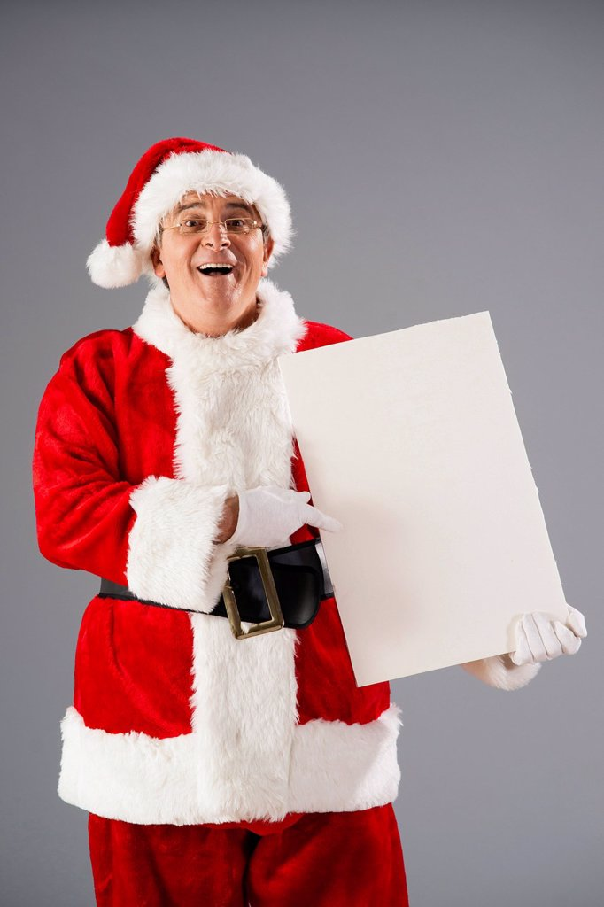 Santa Claus presenting a blank slate : Stock Photo