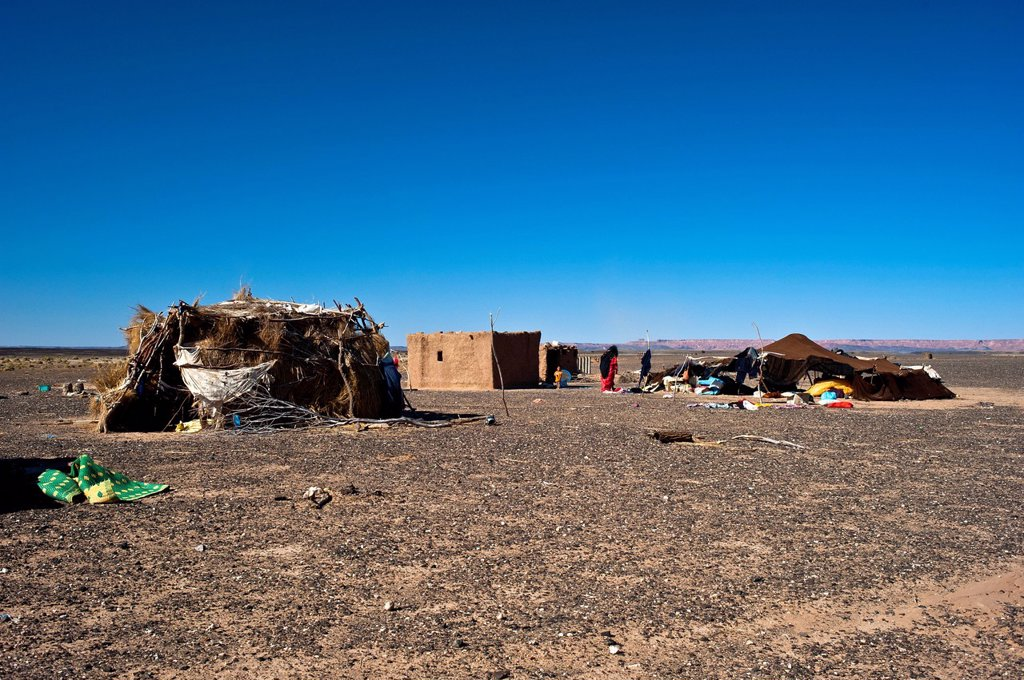 Stock Photo: 1848-727518 Nomad tent and dwellings of a nomadic family on a plateau, stony desert, hamada, Erg Chebbi, Southern Morocco, Morocco, Africa
