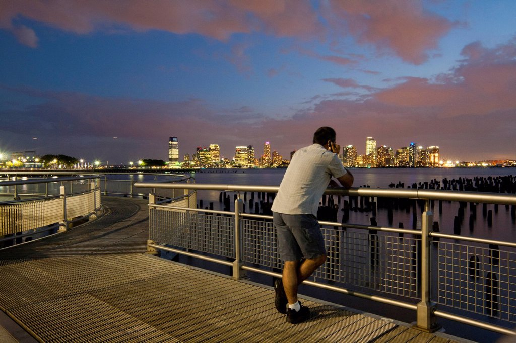 Stock Photo: 1848-727721 Man looking at the skyline, Hudson River Park, near Pier 45, Greenwich Village, Lower West Side, Manhattan, New York City, USA