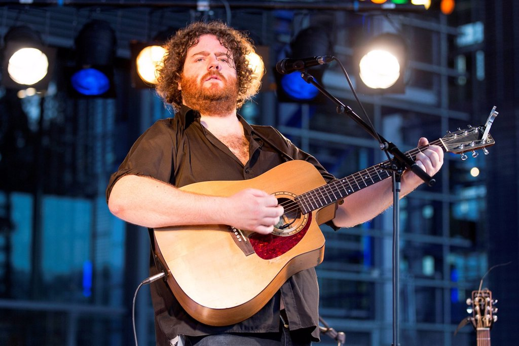 Stock Photo: 1848-728033 The Irish singer and songwriter David Hope playing live in front of the KKL Plaza, Blue Balls Festival, Lucerne, Switzerland, Europe