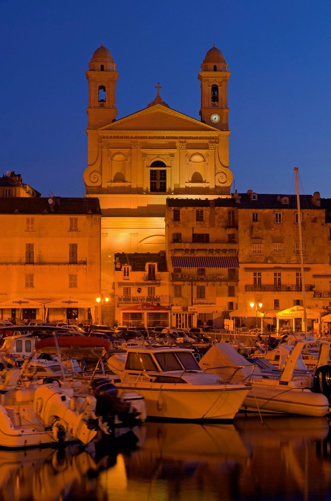 Vieux Port, old harbour of Bastia, with the flood_lit church Saint Jean_Baptiste at back, at the blue hour, Saint Joseph, Bastia, Corse, Corsica, France, Europe : Stock Photo