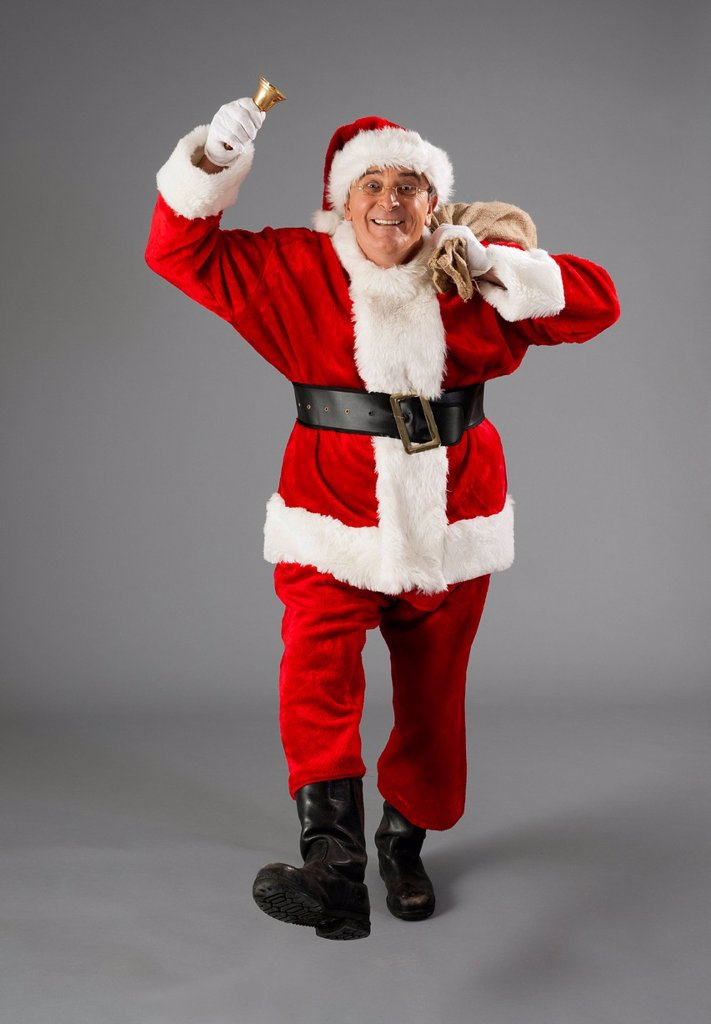 Stock Photo: 1848-728323 Santa Claus with bag and bell
