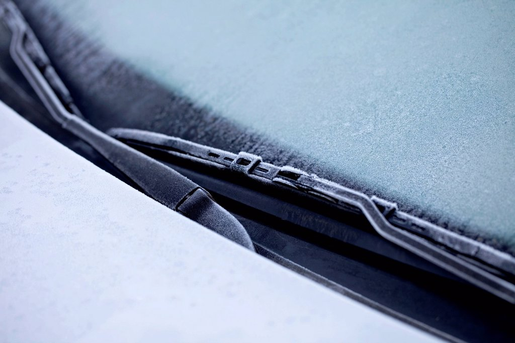 Stock Photo: 1848-728796 Icy car in winter, ice on the windscreen and the windscreen wipers