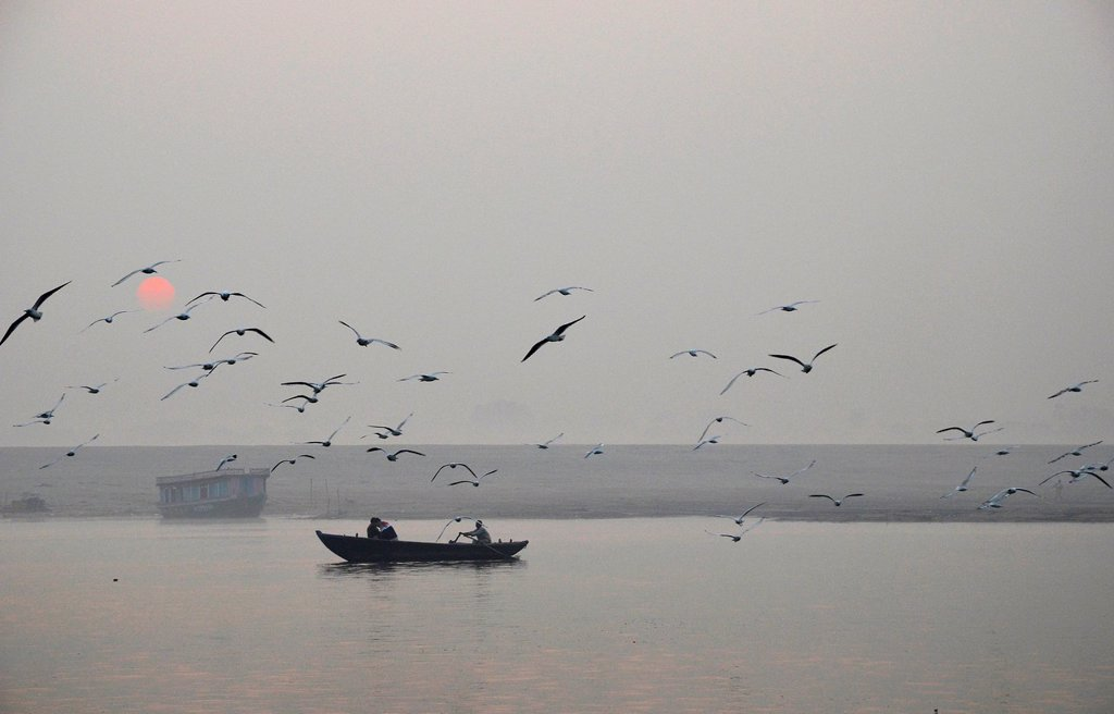 Stock Photo: 1848-730076 Believers in a boat at dawn on the Ganges River, Varanasi, Benares or Kashi, Uttar Pradesh, India, Asia