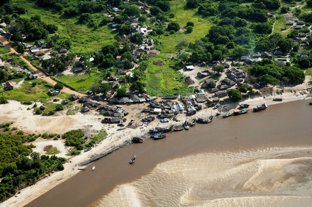 Aerial view, fishing village and boats on the banks of a river, Pwani Region, Tanzania, Africa : Stock Photo