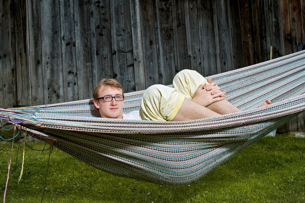 Stock Photo: 1848-730742 Teenager lying in a hammock
