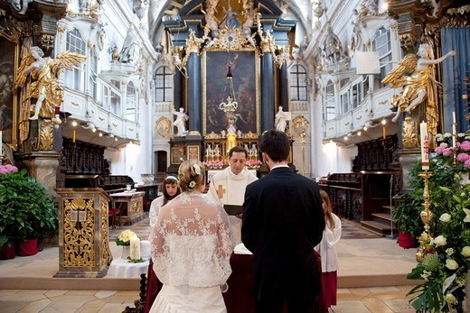 Bride and groom at their wedding in the Basilica of St. Emeran in Regensburg, Bavaria, Germany, Europe : Stock Photo