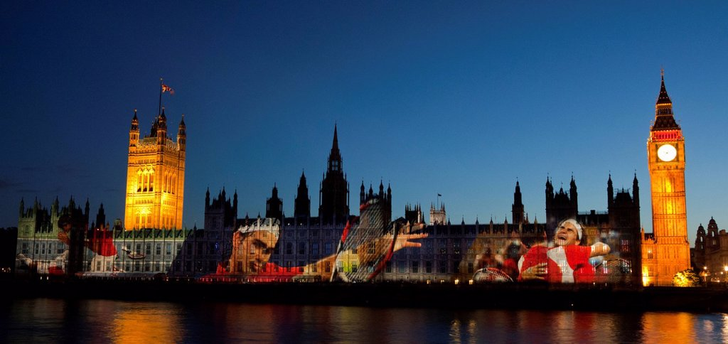 A giant image of Swiss Tennis player Roger Federer is projected onto the facade of the Houses of Parliament for the Olympic and Paralympic Games 2012, London, England, United Kingdom, Europe : Stock Photo