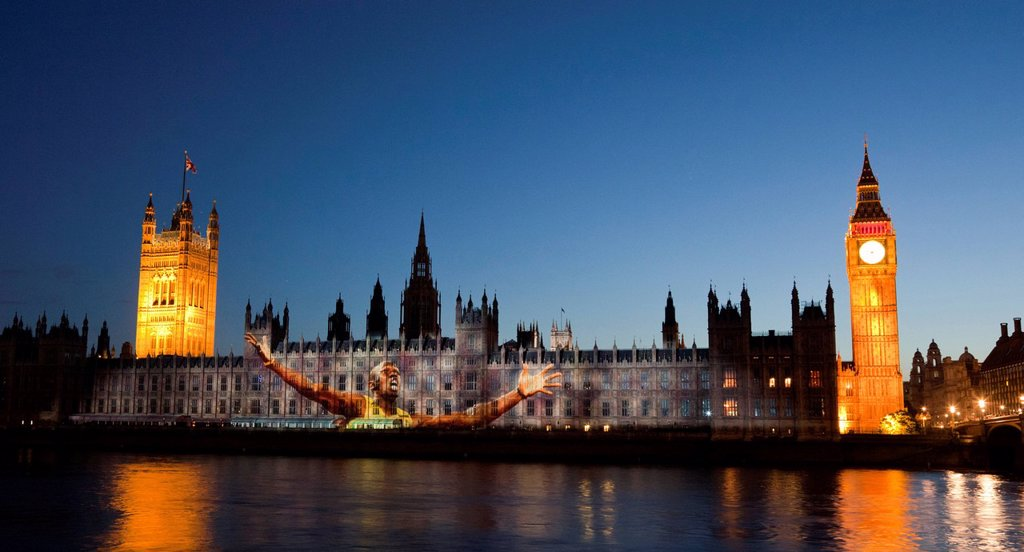 A giant image of Jamaican runner Usain Bolt is projected onto the facade of the Houses of Parliament for the Olympic and Paralympic Games 2012, London, England, United Kingdom, Europe : Stock Photo