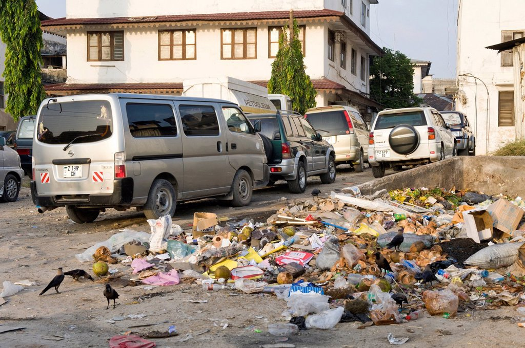 Dumped garbage in a car park, Stone Town, Zanzibar, Tanzania, Africa : Stock Photo