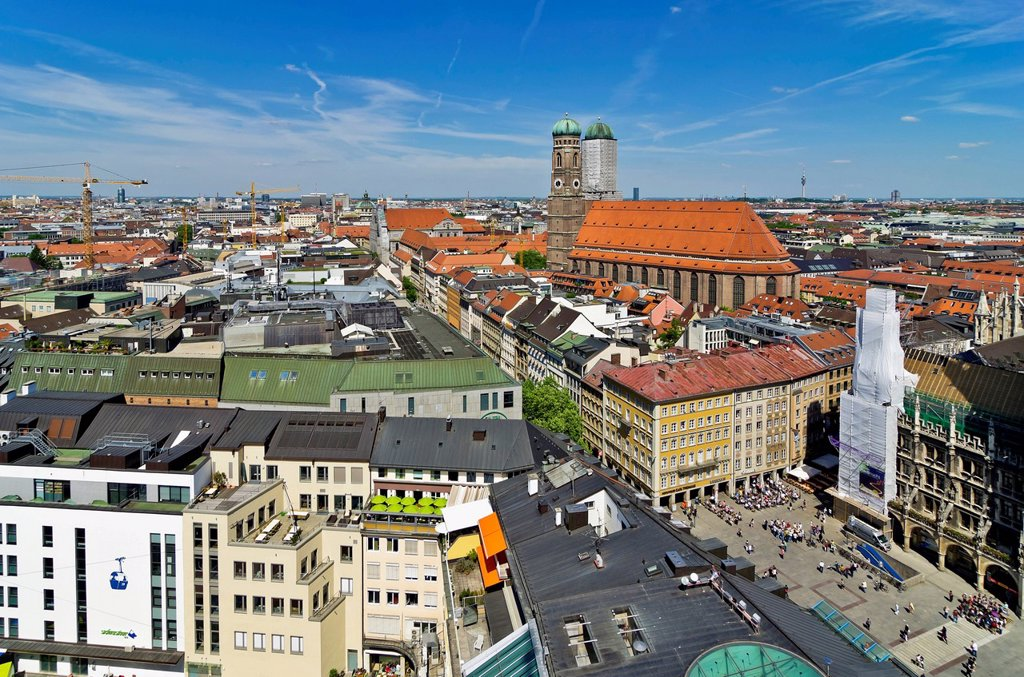 View over the roofs of Munich as seen from the steeple of the Church of St. Peter, Frauenkirche church on the right, Munich, Upper Bavaria, Bavaria, Germany, Europe : Stock Photo