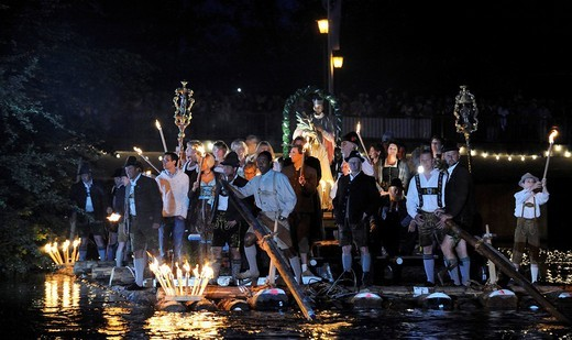 Nightly and unique Johanni_raft_procession on the name day of St John of Nepomuk, every three years raftsmen hold a raft_mass, asking for protection and blessing, Wolfratshausen, Bavaria, Germany, Europe : Stock Photo