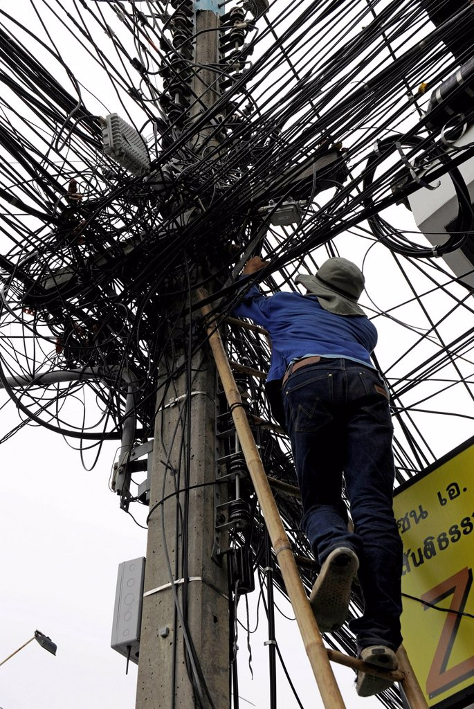 Stock Photo: 1848-740875 Man climbing up a ladder to fix power lines, pylon, Chiang Mai, Thailand, Asia