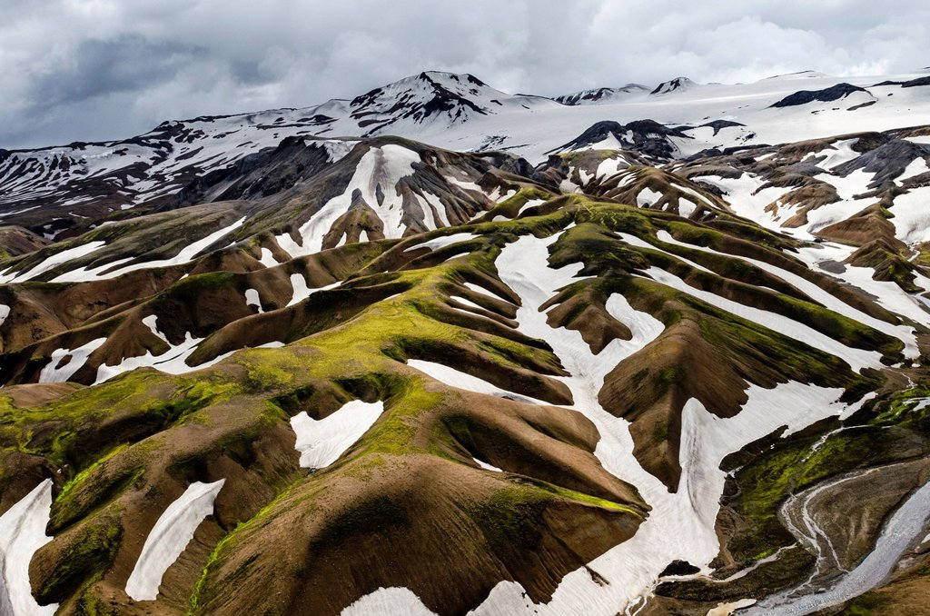 Aerial view, rhyolite mountains partially covered with snow, Landmannalaugar, Fjallabak conservation area, Icelandic Highlands, Iceland, Europe : Stock Photo