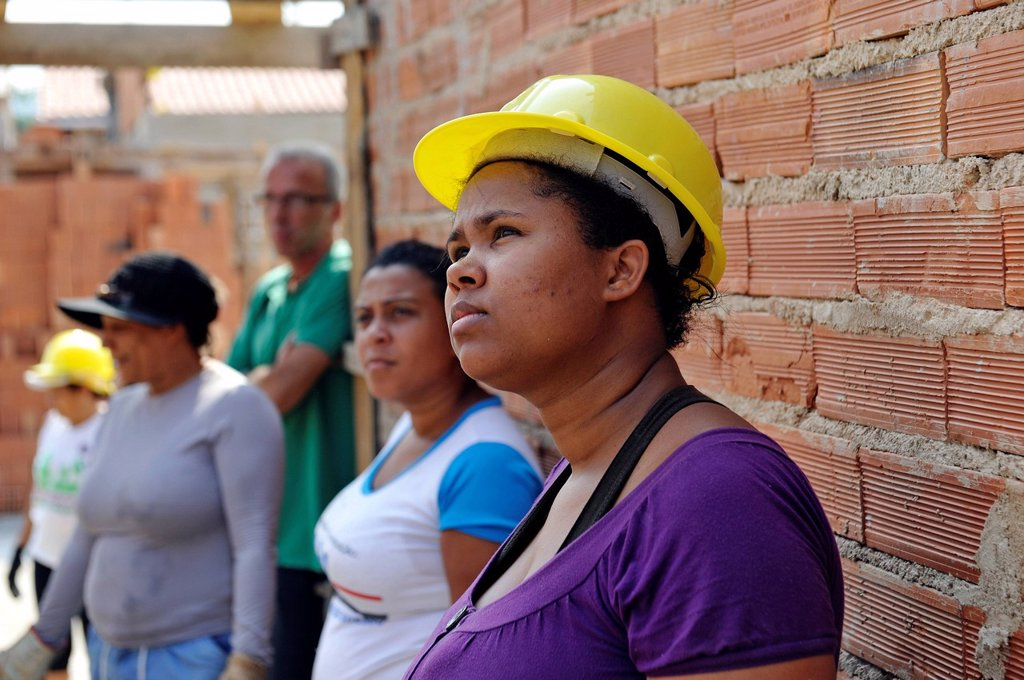 Stock Photo: 1848-742507 Young woman from the slums, favelas, on a building site of the Esperanca housing co_operative, each family helping out on the project and committing to small monthly payments, will get their own house, Jacerepagua neighbourhood, Rio de Janeiro, Brazil, So. Young woman from the slums, favelas, on a building site of the Esperanca housing co_operative, each family helping out on the project and committing to small monthly payments, will get their own house, Jacerepagua neighbourhood, Rio de Janeiro