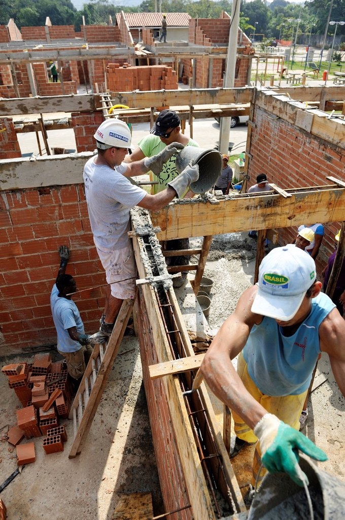 Stock Photo: 1848-742509 People from the slums, favelas, working together on a construction site of the Esperanca housing co_operative, each family helping out on the project and committing to small monthly payments, will get their own house, Jacerepagua neighbourhood, Rio de Jan. People from the slums, favelas, working together on a construction site of the Esperanca housing co_operative, each family helping out on the project and committing to small monthly payments, will get their own house, Jacerepagua neighbourhood