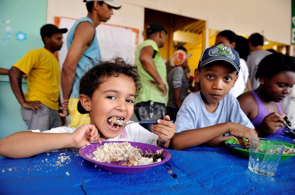 Stock Photo: 1848-742512 Children receiving food in the canteen, Jacerepagua neighbourhood, Rio de Janeiro, Brazil, South America *** IMPORTANT RESTRICTIONS: NO PUBLICATION IN BRAZIL ***