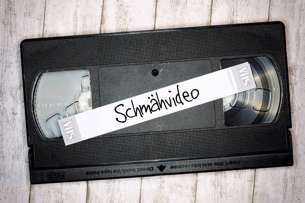 Stock Photo: 1848-743552 Videotape with a sticker, lettering Schmaehvideo, German for defaming video