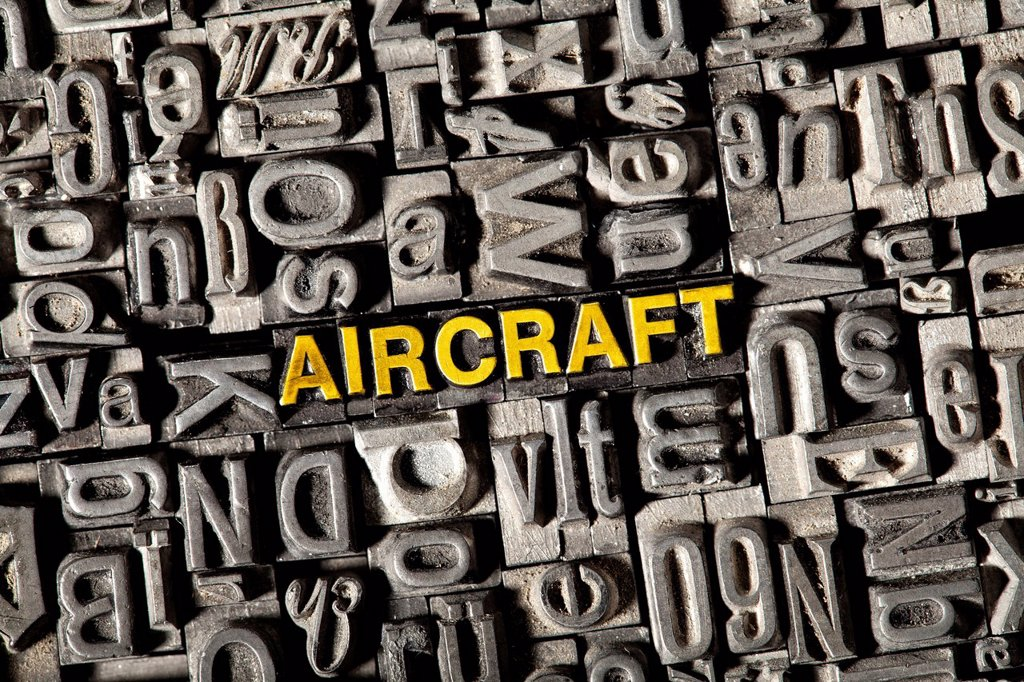Stock Photo: 1848-743580 Old lead letters forming the word aircraft