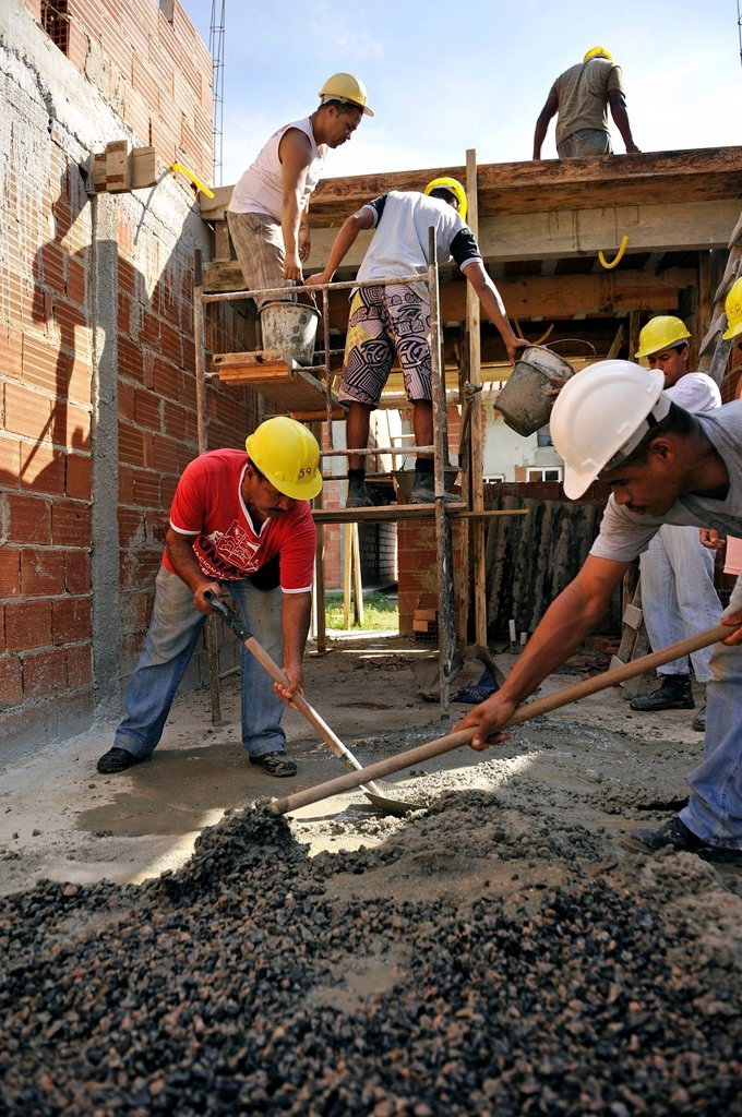 Stock Photo: 1848-743867 Mixing of concrete, people from the slums, favelas, working on a building site of the Esperanca housing co_operative, each family helping out on the project and committing to small monthly payments, will get their own house, Jacerepagua neighbourhood, Rio. Mixing of concrete, people from the slums, favelas, working on a building site of the Esperanca housing co_operative, each family helping out on the project and committing to small monthly payments, will get their own house, Jacerepagua neighb