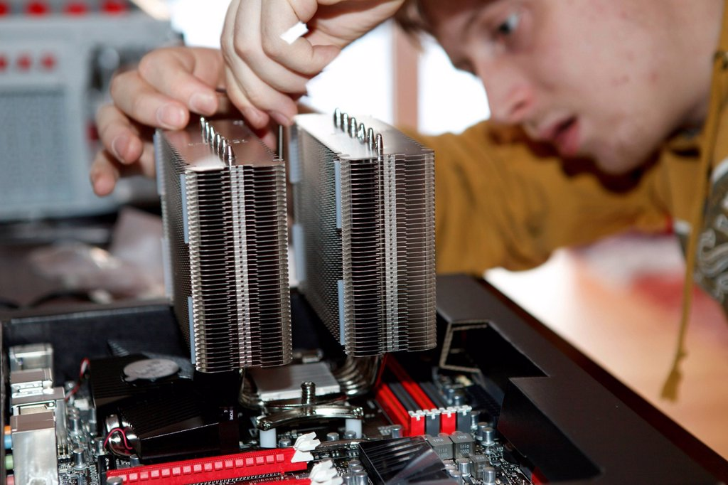 Young man assembling a computer : Stock Photo